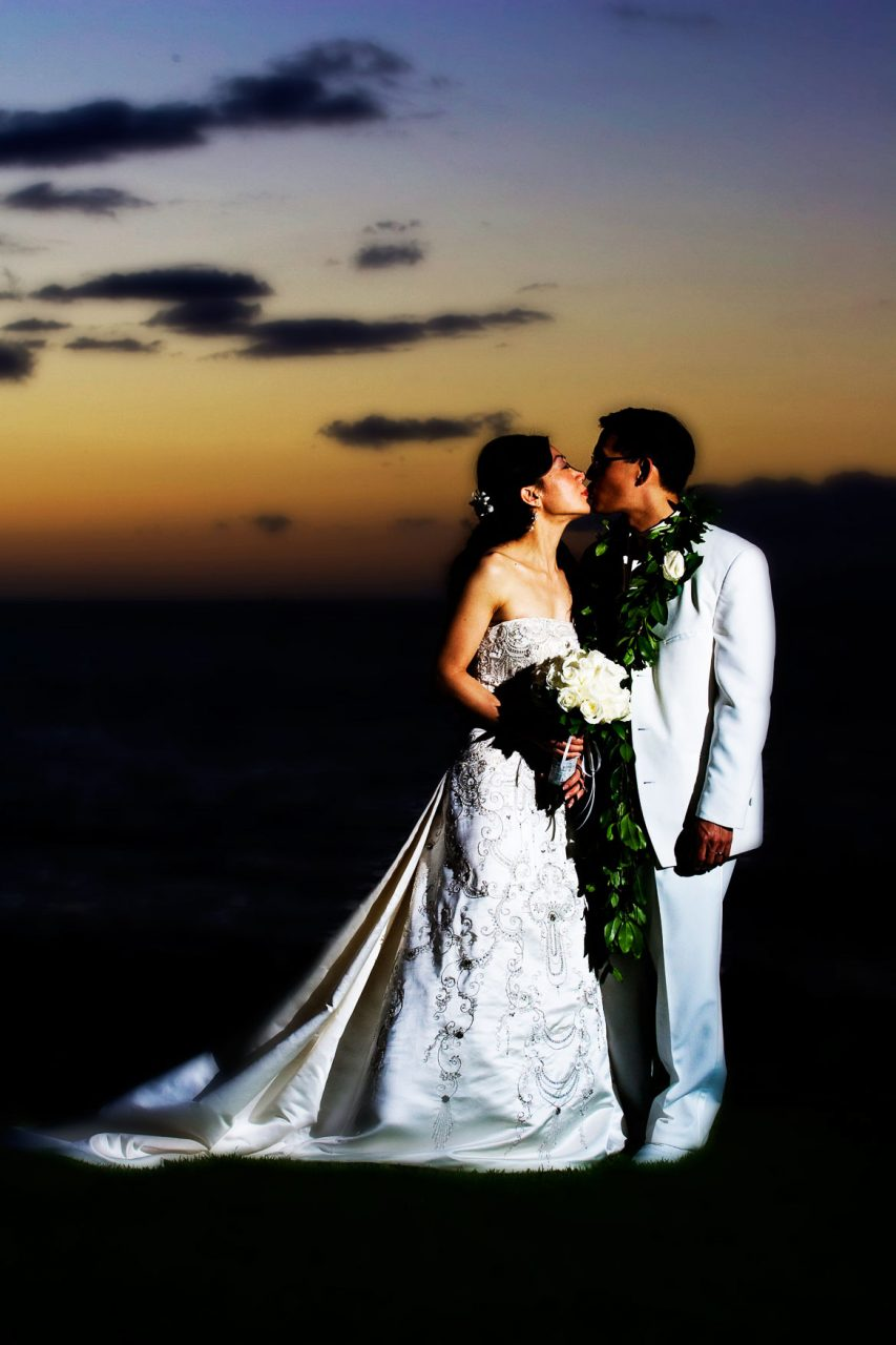 Maui Bride and Group Kissing on Beach
